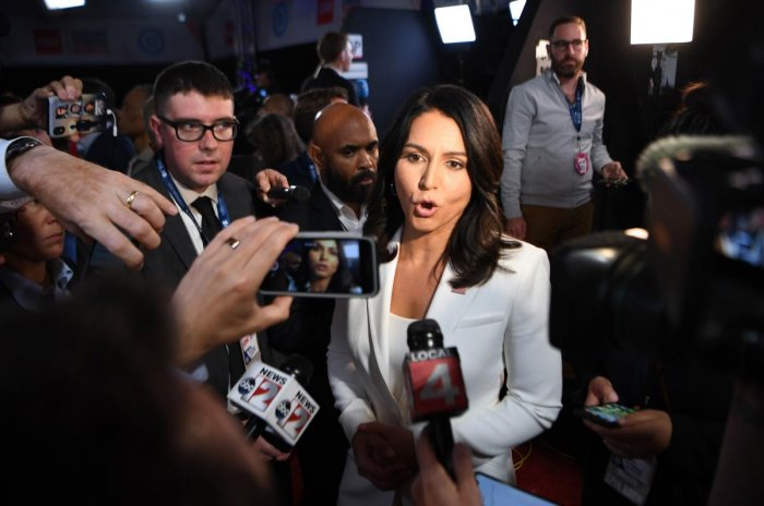 Tulsi Gabbard speaks to reporters in the spin room after the second round of the second Democratic primary debate of the 2020 presidential campaign season hosted by CNN (AFP Photo)