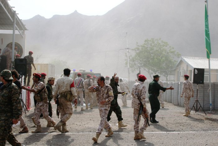 Soldiers rush to help the injured following a missile attack on a military parade during a graduation ceremony for newly recruited troopers in Aden, Yemen. Reuters photo