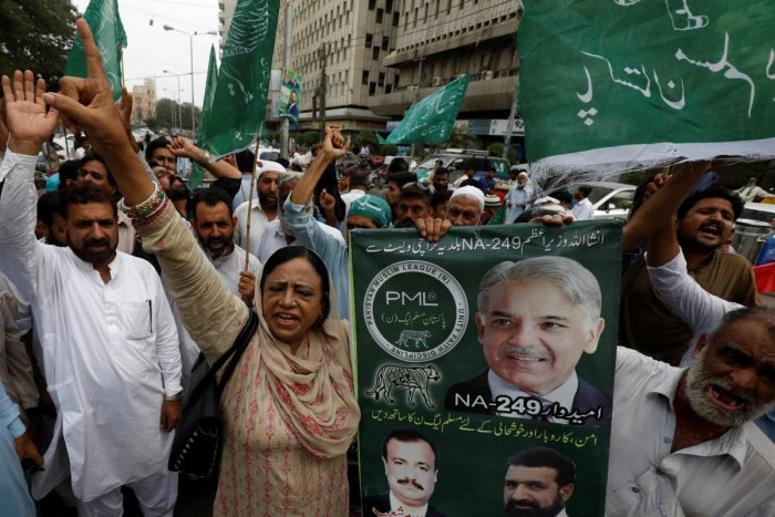 Supporters of Shehbaz Sharif, brother of ousted prime minister Nawaz Sharif and leader of Pakistan Muslim League -Nawaz (PML-N), chant slogans against what they say is alleged rigging by the Election Commission of Pakistan (ECP) during the general electio