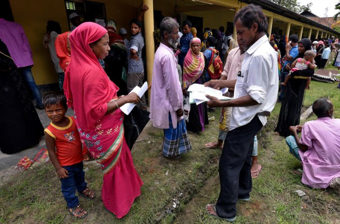 Villagers wait outside the National Register of Citizens (NRC) centre to get their documents verified by government officials, at Mayong Village in Morigaon district, in the northeastern state of Assam, India July 8, 2018. Picture taken July 8, 2018. REUTERS/Anuwar Hazarika