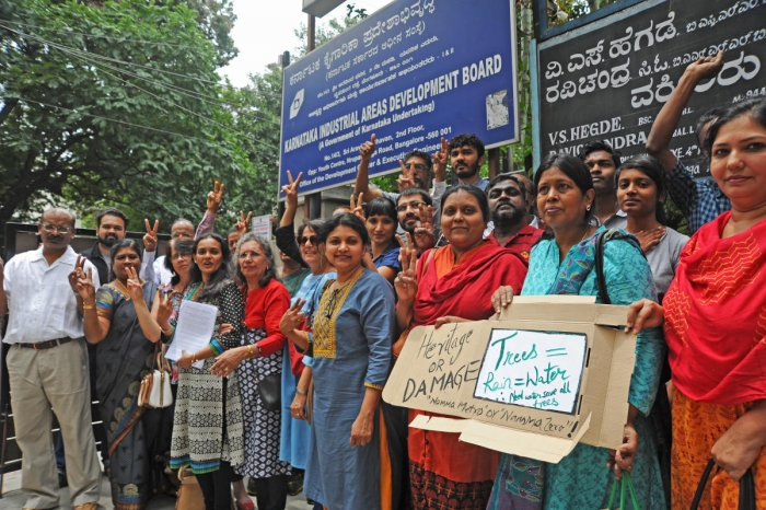 Members of All Saints Church submit documents at Karnataka Industrial Areas Development Board at Nrupathunga Road in Bengaluru on Tuesday. | DH Photo: Pushkar V