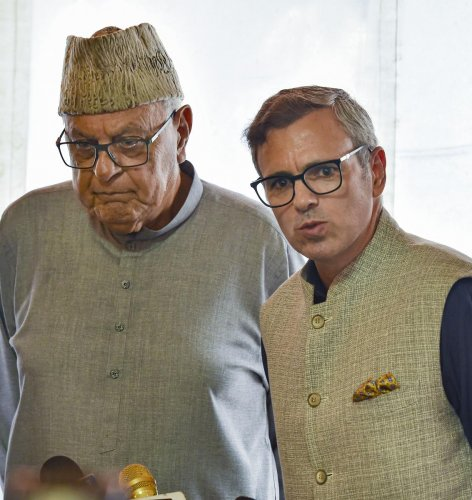 New Delhi: National Congress President Farooq Abdullah with party Vice-President Omar Abdullah address the media after their meeting with Prime Minister Narendra Modi, at the Parliament in New Delhi, Thursday, Aug 1, 2019. (PTI Photo)