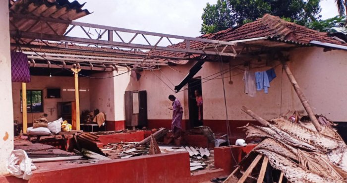A house damaged due to cloud storm at Pervaje in Karkala taluk on Thursday.