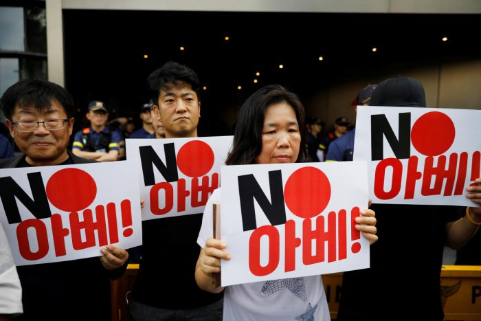 "Protesters hold signs during an anti-Japan rally in front of the Japanese embassy in Seoul, South Korea,The sign reads ""NO Abe"". (Reuters Photo)"