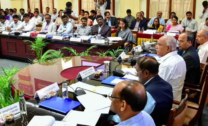 Chief Minister B S Yediyurappa at a meeting with regional commissioners, deputy commissioners and chief executive officers of Zilla Panchayats, in Vidhana Soudha on Bengaluru. DH Photo