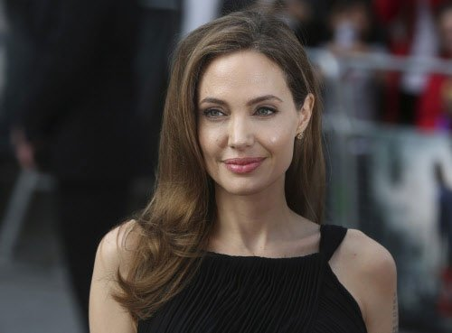 Angelina Jolie gets new arm tattoo