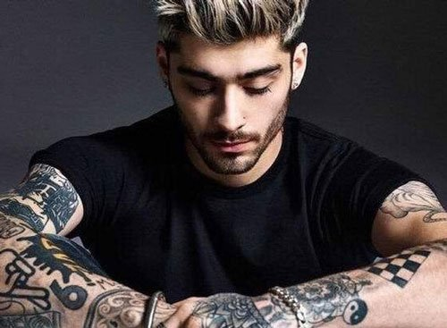 Zayn Malik gets a lightsaber tattoo that actually glows
