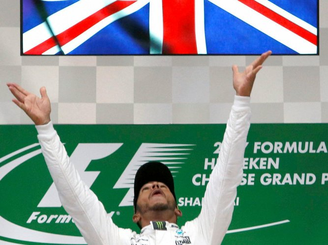 Lewis Hamilton coasts to fifth title at Chinese Grand Prix