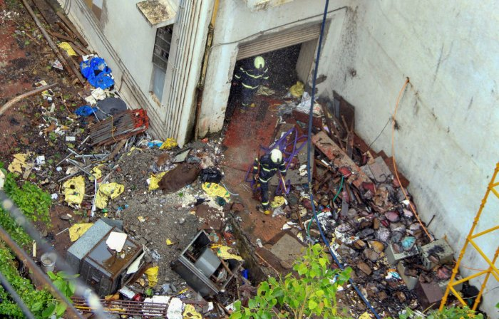 Debris seen scattered around as fire fighters conduct cooling operations a day after a fire broke out at the MTNL building in Bandra, Mumbai last week (PTI File Photo)