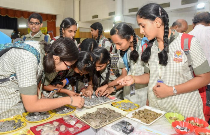 Glimpse of the past: Students viewing coins and other artefacts displayed at an exhibition at Karnataka Numismatic Society in Bengaluru. DH Photos/ Anup R Thippeswamy