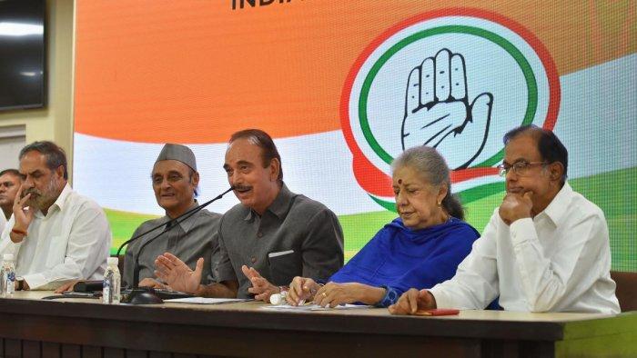Senior Congress leader Ghulam Nabi Azad addresses the media as party leaders (L-R) Anand Sharma, Karan Singh, Ambika Soni and P Chidambaram look on, in New Delhi (PTI Photo)