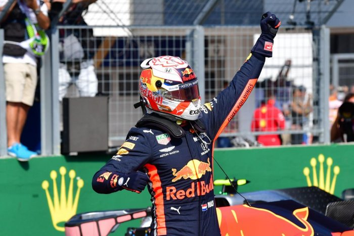 Max Verstappen celebrates after he took his maiden pole position in Formula One (AFP Photo)