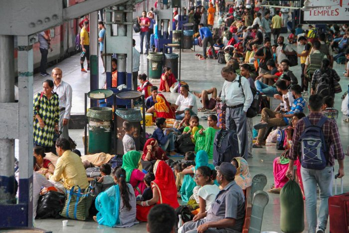 Tourists and Amarnath Yatris wait at Jammu Railway Station to leave for their homes after the J & K government issued a security advisory asking them to curtail their stay in the state (PTI Photo)