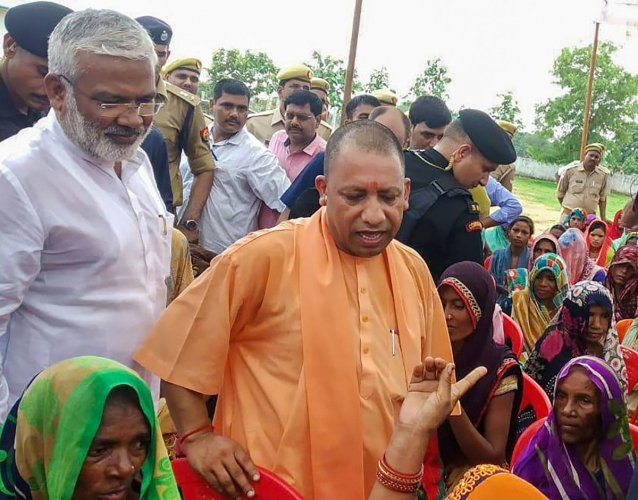 Uttar Pradesh Chief Minister Yogi Adityanath meets the members of the aggrieved families of the in Sonbhadra last month (PTI File Photo)