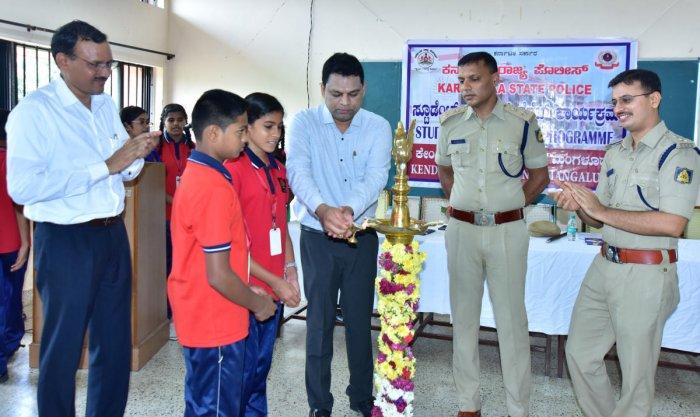 Assistant Commissioner Ravichandra Nayak inaugurates Student Police Cadet at Kendriya Vidyalaya-2 in Ekkur, Mangaluru, on Saturday.