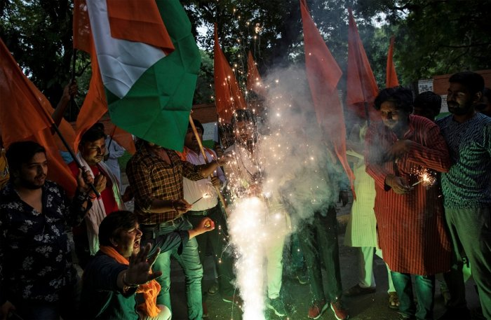 Bharatiya Janata Party (BJP) on Monday celebrated revocation of Article 370 of the Constitution by distributing ladoos and bursting firecrackers in Himachal Pradesh's capital Shimla. (Reuters Photo)