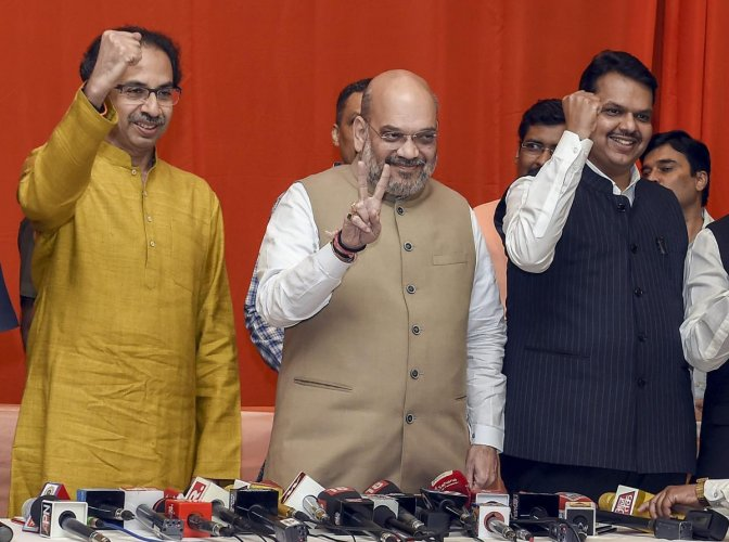 BJP President Amit Shah flanked by Shiv Sena President Uddhav Thackeray and Maharashtra CM Devendra Fadnavis during the announcement of an alliance between Shiv Sena and BJP for Lok Sabha and Assembly polls, in Mumbai. PTI