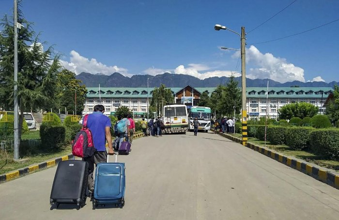 National Institute of Technology students leave the Valley after the institute decided to suspend classes amid panic over troop build-up in Srinagar on Saturday. PTI