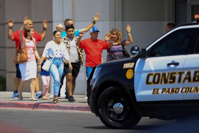Shoppers exit with their hands up after a mass shooting at a Walmart in El Paso, Texas, U.S. August 3, 2019. REUTERS/Jorge Salgado NO RESALES. NO ARCHIVES. TPX IMAGES OF THE DAY