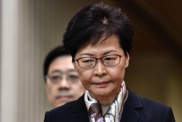 With commuters unable to get to work and international travellers facing delays, chief executive Carrie Lam held a press conference to warn protesters and signal authorities would not buckle under the growing pressure. (AFP)