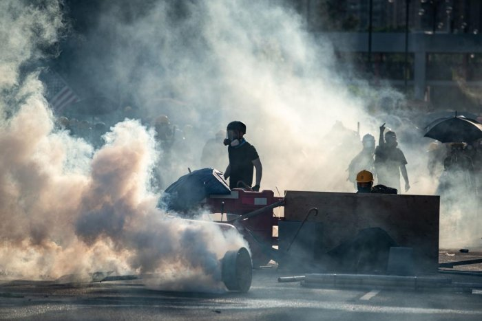 The past fortnight has seen a surge in violence on both sides of the protests, with police repeatedly firing rubber bullets and tear gas to disperse increasingly hostile projectile-throwing crowds. (AFP Photo)