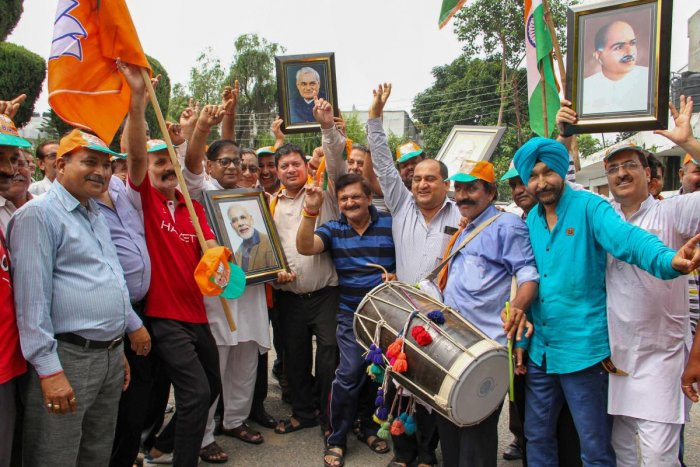 BJP workers celebrate government decision to revoke Article 370 that gave special status to Jammu and Kashmir and a separate bill to bifurcate the state into two separate union territories of Jammu and Kashmir and Ladakh. PTI photo