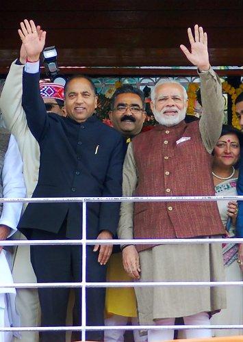 Prime Minister Narendra Modi with New Chief Minister of Himachal Pradesh Jairam Thakur. (PTI Photo)