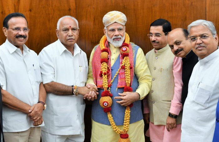 Chief Minister B S Yediyurappa meets Prime Minister Narendra Modi at New Delhi on Tuesday. DH photo