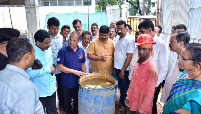 Mangalore City South MLA D Vedavyas Kamath along with volunteers creates awareness among construction workers on breeding of mosquitoes in stagnant water at Mannagudda, in Mangaluru. DH Photo