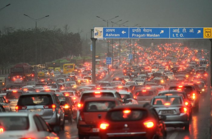 A view of the traffic jam at NH-24 during a heavy downpour, in New Delhi on Tuesday. (PTI Photo)