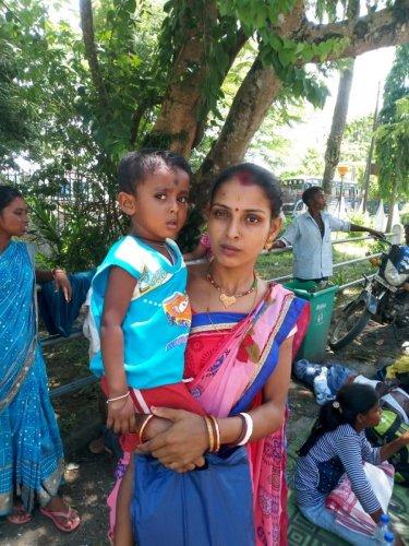 Gitanjali Sarkar with her son outside Divasagar circuit house on Tuesday. Photo by Zamsher Ali.