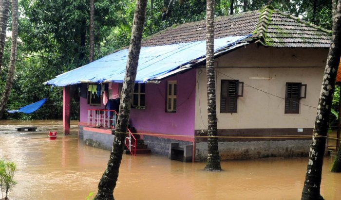 An inundated house in Udupi. DH file photo
