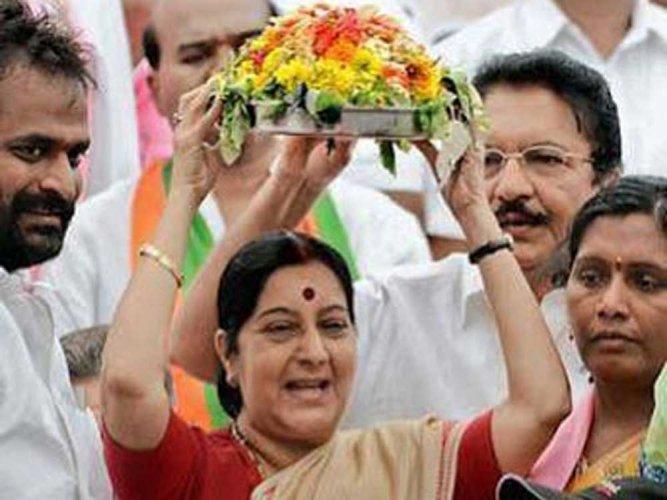 Sushma Swaraj with traditional Bonalu (offering to Goddess) of Telangana. DH file photo