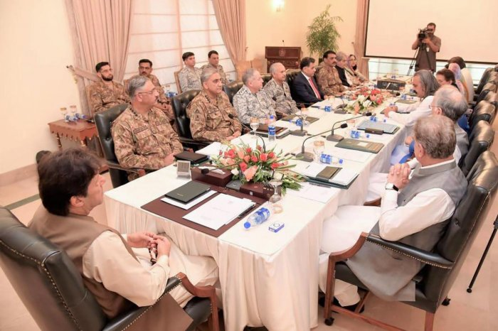 In this handout picture released by Press Information Department (PID) on August 4, 2019, Pakistan Prime Minister Imran Khan (L) chairs the National Security Committee meeting in Islamabad. (AFP PHOTO / PID)
