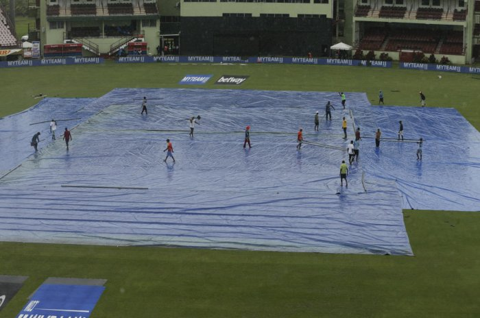 he pitch of the National Stadium is covered by the tarp as rain falls prior the India and West Indies third T20 international cricket match in Providence, Guyana. AP Photo