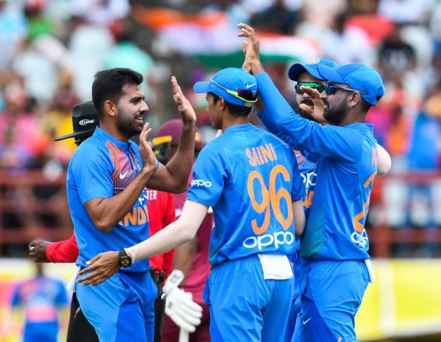 Indian pacer Deepak Chahar (left) celebrates with team-mates after dismissing West Indies opener Sunil Narine in the third T20I match in Guyana on Tuesday. AFP
