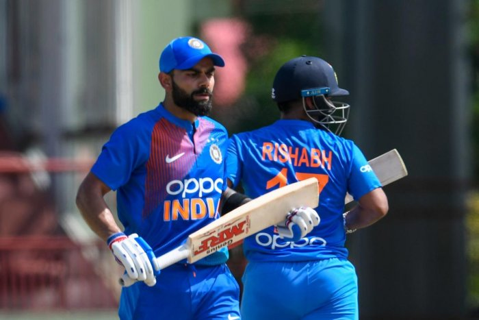 Virat Kohli (L) and Rishabh Pant (R) of India 100 partnership during the 3rd T20i match between West Indies and India at Guyana National Stadium in Providence, Guyana, on August 6, 2019. (AFP)