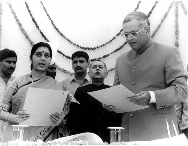 In this December 10, 1998 file photo, is seen Sushma Swaraj being sworn in as chief minister of Delhi by then Lt. Governor Vijay Kapoor at Raj Bhavan in New Delhi. (PTI File Photo)