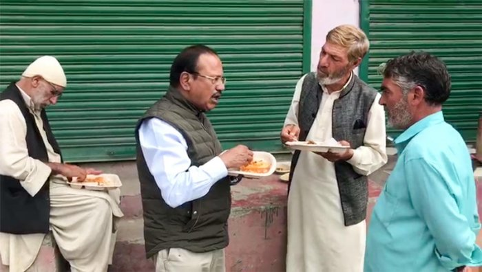 National Security Advisor Ajit Doval interacts with the locals while reviewing security situation in Shopian. (PTI Photo)