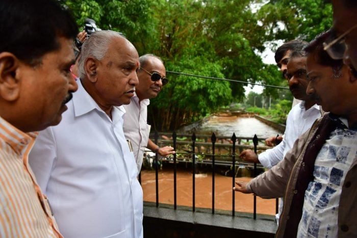 Chief Minister B S Yediyurappa inspecting the flooded SPM Road and Shivaji Garden area area in Belagavi on Thursday.