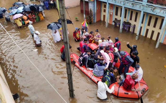 National Disaster Response Force (NDRF) conducts a rescue operation at a flooded area of Tambve village in Karad. (PTI Photo)