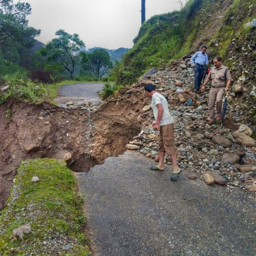 A portion of a road caved due to heavy rain following a cloudburst, in Chamoli district, Friday, Aug 9, 2019. (PTI Photo)