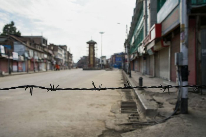 A view of a deserted street during restrictions at Lal Chowk in Srinagar. (PTI Photo/S. Irfan)