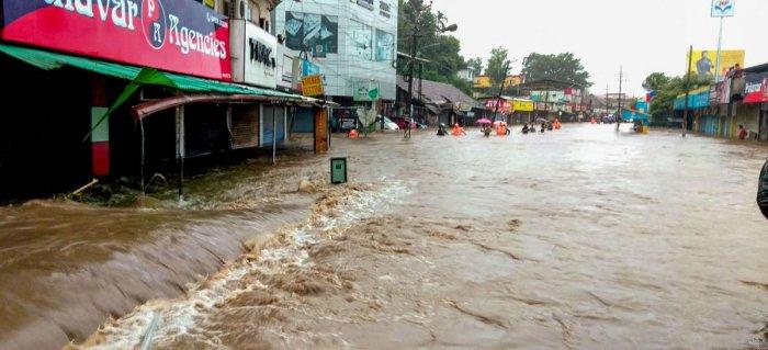A flooded street following incessant monsoon rainfall, at Kalpetta in Wayanad on Friday. PTI photo