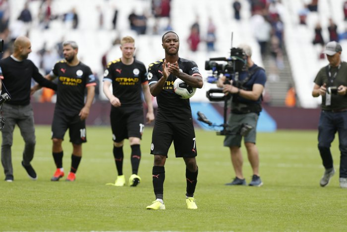 Manchester City's English midfielder Raheem Sterling applauds as he carries the match ball after scoring a hatttick to help his team win 5-0 during the English Premier League football match between West Ham United and Manchester City. (AFP Photo)