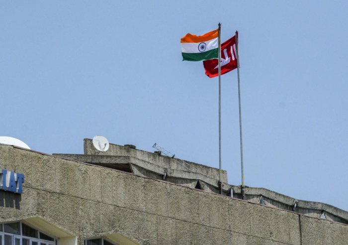 Indian national flag and Jammu and Kashmir state flag stand hoisted at a building during restrictions in Srinagar, Thursday, Aug 8, 2019. (PTI File Photo)