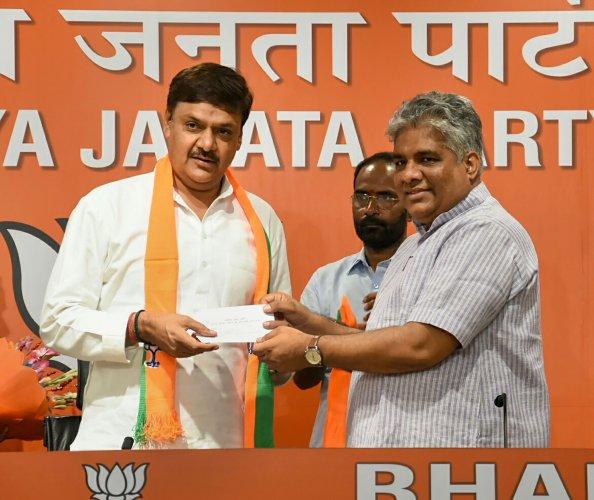 Former Samajwadi Party leader and Rajya Sabha MP Surendra Nagar joins BJP in the presence of senior party leader Bhupendra Yadav. (PTI Photo)
