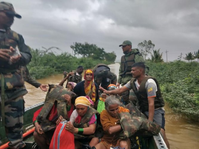 Army troops help rescue civilians in Belgaum District on August 8, 2019.
