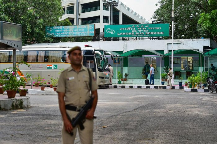 A security personnel stands guard as passengers board the Delhi-Lahore bus, also known as Sada-e-Sarhad, at Ambedkar terminal in New Delhi, Friday, Aug 9, 2019. (PTI File Photo)