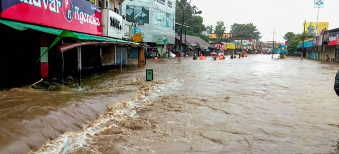 A flooded street following incessant monsoon rainfall, at Kalpetta in Wayanad on Friday. (PTI Photo)